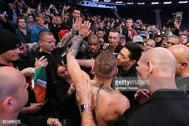 Featherweight Champion Conor McGregor high fives fans after UFC 205 Open Workouts at Madison Square Garden on November 9 2016 in New York City
