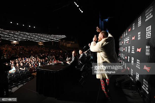 UFC featherweight champion Conor McGregor of Ireland arrives late for the UFC 205 press conference inside The Theater at Madison Square Garden on...