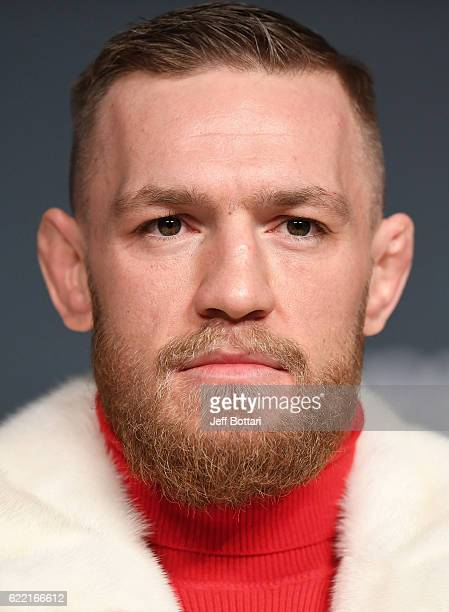 UFC featherweight champion Conor McGregor of Ireland interacts with fans and media during the UFC 205 press conference inside The Theater at Madison...