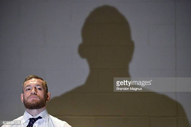 Featherweight champion Conor McGregor of Ireland relaxes backstage at Madison Square Garden prior to his lightweight championship fight against Eddie...