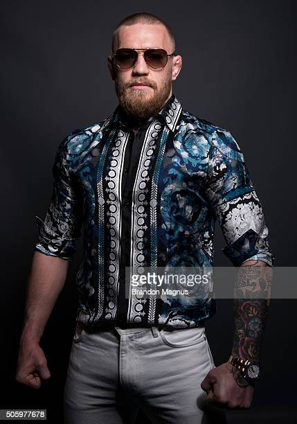 UFC featherweight champion Conor McGregor poses for a portrait backstage during the UFC 197 onsale press conference event inside MGM Grand Hotel...