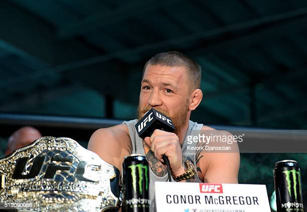 UFC featherweight champion Conor McGregor speaks during a news conference with lightweight contender Nate Diaz at UFC Gym February 24 in Torrance...