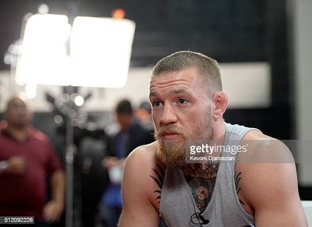 UFC featherweight champion Conor McGregor speaks during an interview after a news conference with lightweight contender Nate Diaz at UFC Gym February...