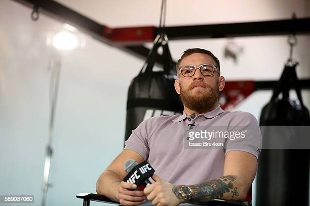 UFC featherweight champion Conor McGregor speaks to members of the media during an open workout at his gym on August 12 2016 in Las Vegas Nevada...