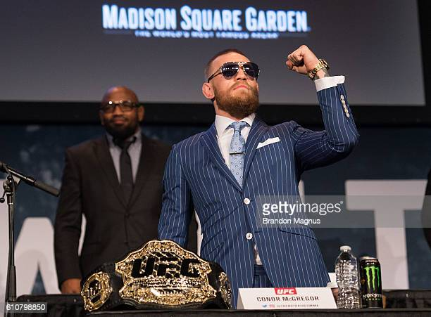 UFC featherweight champion Conor McGregor walks onto the stage during the UFC 205 press event at Madison Square Garden on September 27 2016 in New...