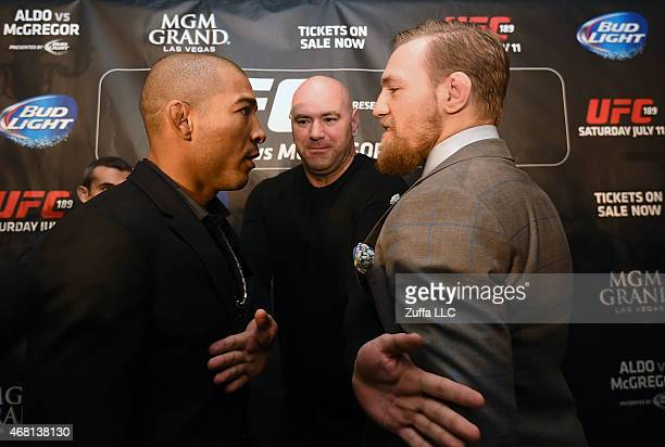 Featherweight Champion Jose Aldo and UFC Featherweight Contender Conor McGregor face off during the UFC 189 World Championship Press Tour on March 30...