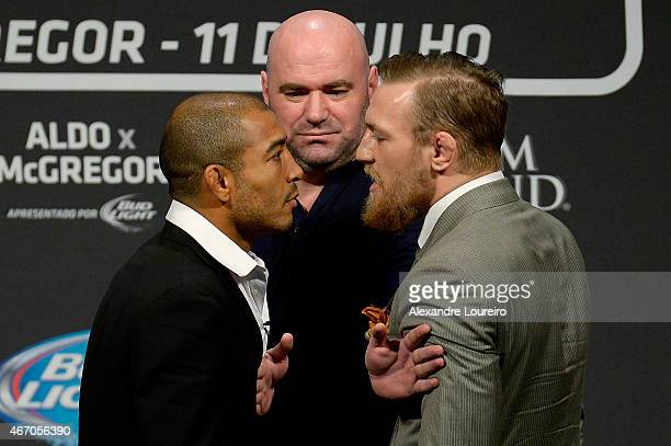 UFC featherweight champion Jose Aldo of Brazil and challenger Conor McGregor of Irleland face off as UFC President Dana White stands in during the...