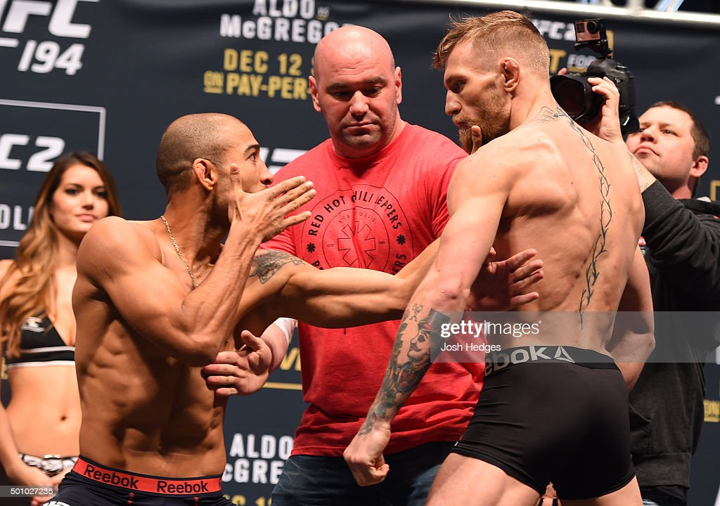 UFC featherweight champion Jose Aldo of Brazil and interim UFC featherweight champion Conor McGregor of Ireland face off during the UFC 194 weigh-in inside MGM Grand Garden Arena on December 10, 2015 in Las Vegas, Nevada.