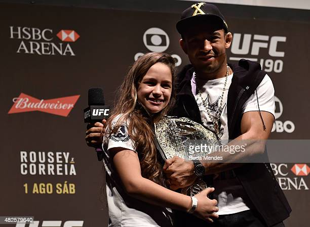 Featherweight Champion Jose Aldo of Brazil interacts with a fan during a Q&A session prior to the UFC 190 Rousey v Correia weigh-in at HSBC Arena on...