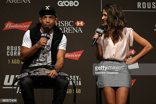 Featherweight Champion Jose Aldo of Brazil interacts with fans during a Q&A session before the UFC 190 Rousey v Correia weigh-in at HSBC Arena on...