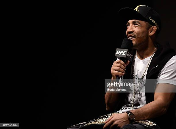 Featherweight Champion Jose Aldo of Brazil interacts with fans during a Q&A session prior to the UFC 190 Rousey v Correia weigh-in at HSBC Arena on...