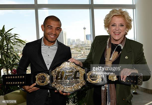 UFC Featherweight Champion Jose Aldo poses with Las Vegas Mayor Carolyn Goodman during the UFC 189 World Championship Press Tour at Las Vegas City...