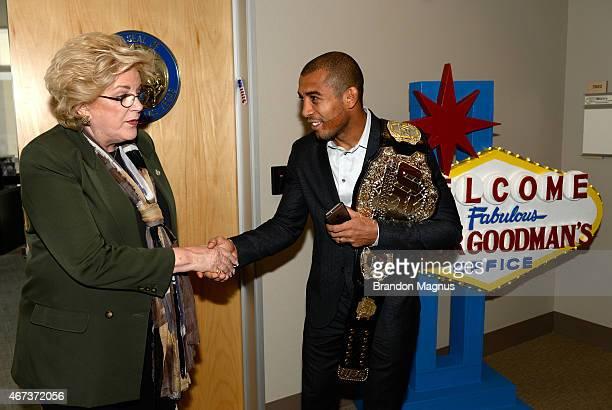 UFC Featherweight Champion Jose Aldo shakes hands with Las Vegas Mayor Carolyn Goodman during the UFC 189 World Championship Press Tour at Las Vegas...