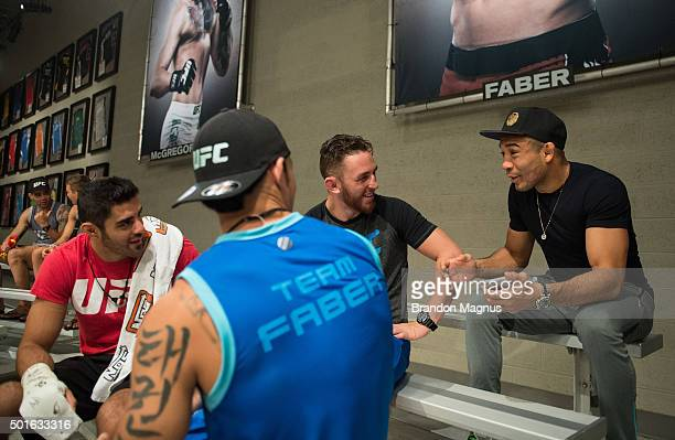 UFC featherweight champion Jose Aldo watches the semifinal fights during the filming of The Ultimate Fighter Team McGregor vs Team Faber at the UFC...
