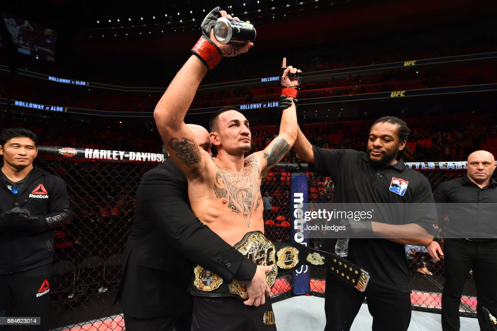 UFC featherweight champion Max Holloway celebrates after defeating Jose Aldo of Brazil in their UFC featherweight championship bout during the UFC 218 event inside Little Caesars Arena on December 02, 2017 in Detroit, Michigan.