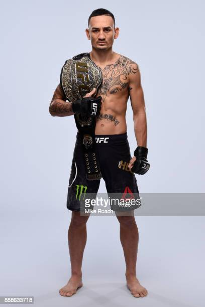 UFC featherweight champion Max Holloway poses for a portrait during a UFC photo session on November 29 2017 in Detroit Michigan