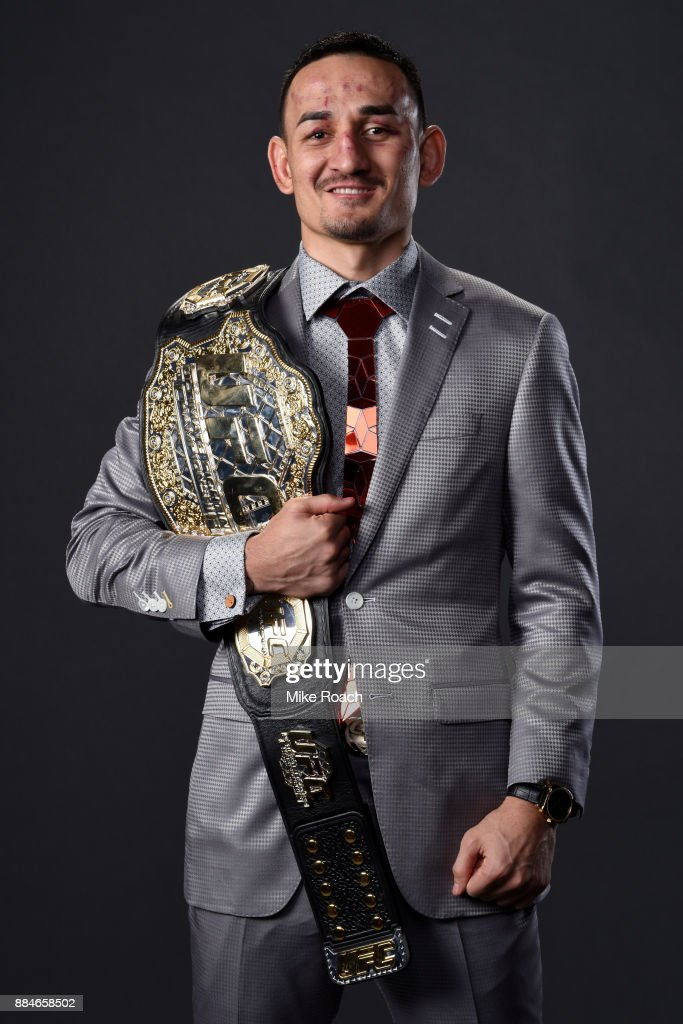 UFC featherweight champion Max Holloway poses for a post fight portrait backstage during the UFC 218 event inside Little Caesars Arena on December 02, 2017 in Detroit, Michigan.