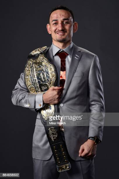 UFC featherweight champion Max Holloway poses for a post fight portrait backstage during the UFC 218 event inside Little Caesars Arena on December 02...