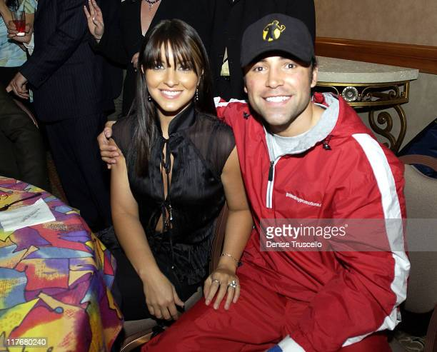 WBC Featherweight Champion Oscar De La Hoya suffered a sprained hand during the fight seen here with his wife Millie as they celebrate the victory