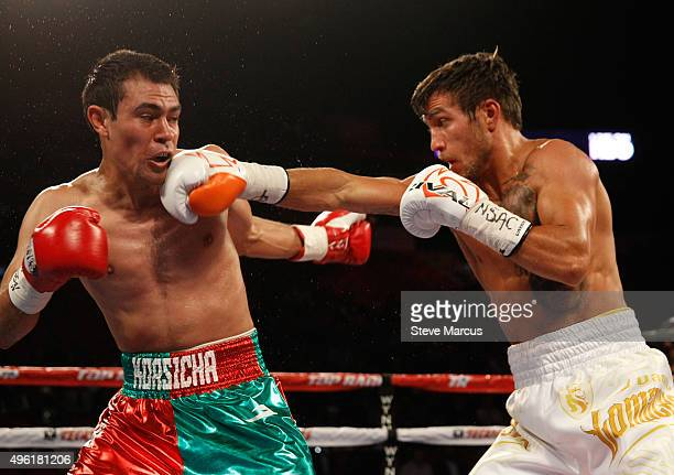 WBO featherweight champion Vasyl Lomachenko lands a punch on Romulo Koasicha during their title fight at the Thomas Mack Center on November 7 2015 in...