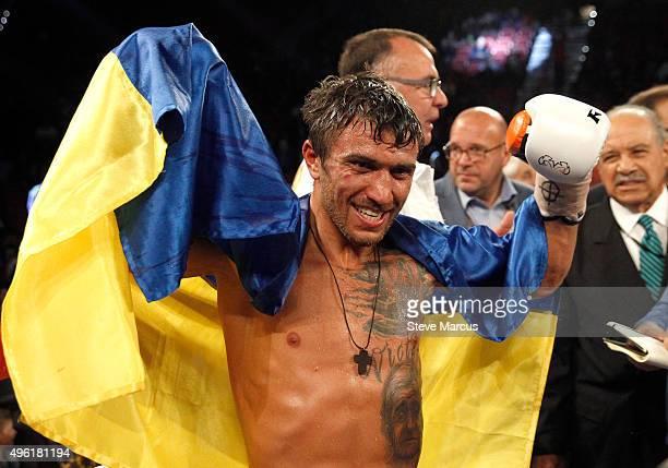 WBO featherweight champion Vasyl Lomachenko poses after defeating Romulo Koasicha in their title fight at the Thomas Mack Center on November 7 2015...