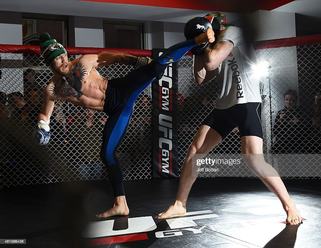UFC featherweight Conor McGregor of Ireland (L) holds an open training session for the media and fans at UFC Gym on January 15, 2015 in Boston, Massachusetts.