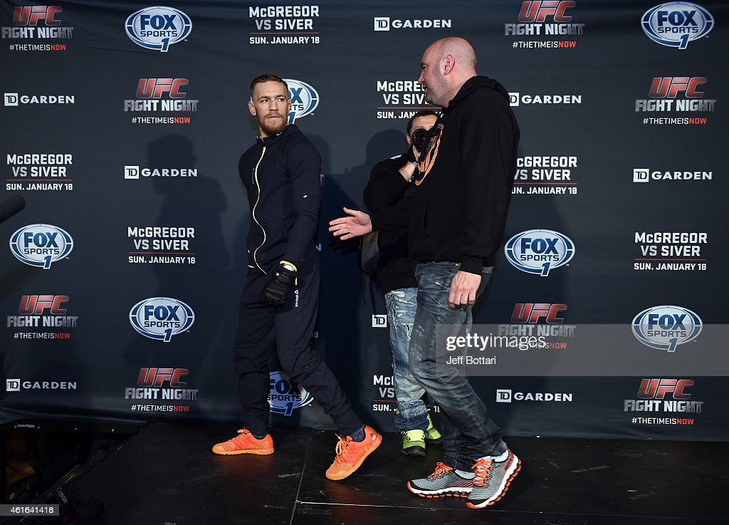UFC featherweight Conor McGregor of Ireland (L) interacts with UFC President Dana White at Faneuil Hall on January 16, 2015 in Boston, Massachusetts.