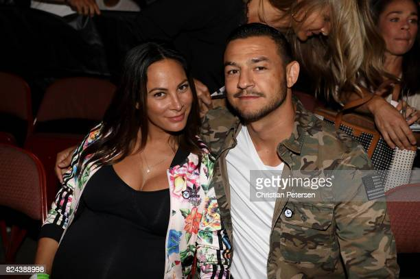 UFC featherweight contender Cub Swanson and fiance Kenda Perez are seen in attendance during the UFC 214 event at Honda Center on July 29 2017 in...