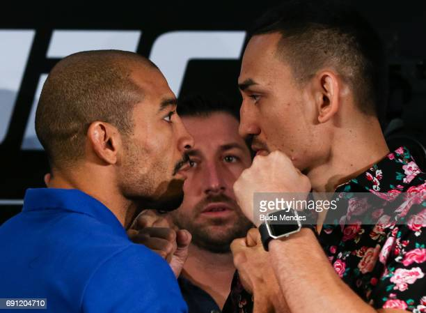 UFC featherweight fighters Jose Aldo of Brazil and Max Holloway of the United States face off during Ultimate Media Day at Windsor Hotel on June 01...
