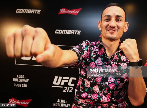 UFC featherweight interim champion Max Holloway of the United States pose for photographers during Ultimate Media Day at Windsor Hotel on June 01...