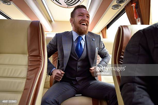 UFC featherweight title challenger Conor McGregor of Ireland arrives for the UFC 189 World Championship Press Tour press conference inside the Hotel...