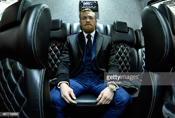 UFC featherweight title challenger Conor McGregor of Ireland waits on his bus before entering the UFC 189 World Championship Press Tour press...