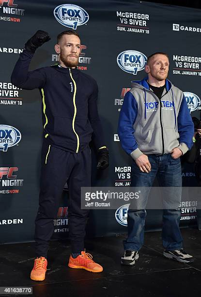 UFC featherweights Conor McGregor of Ireland and Dennis Siver of Germany interact with media at Faneuil Hall on January 16 2015 in Boston...