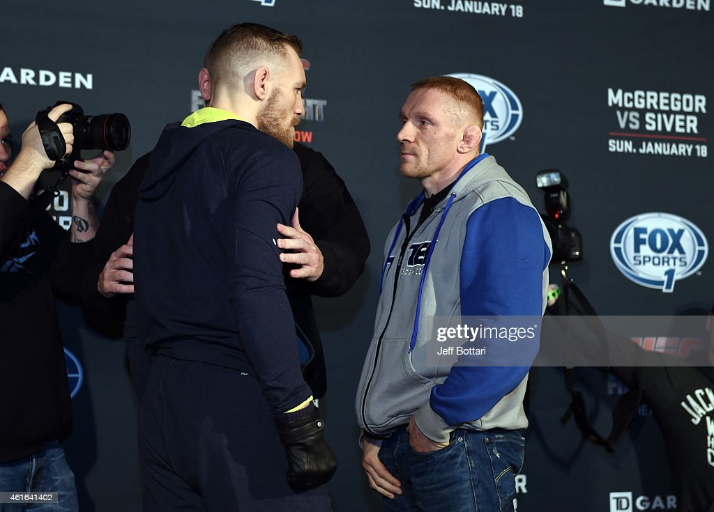 UFC featherweights Conor McGregor of Ireland (L) and Dennis Siver of Germany face off for the media at Faneuil Hall on January 16, 2015 in Boston, Massachusetts.