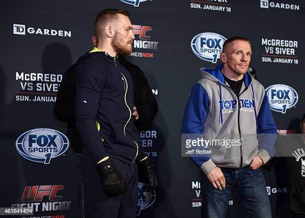 UFC featherweights Conor McGregor of Ireland and Dennis Siver of Germany face off for the media at Faneuil Hall on January 16 2015 in Boston...