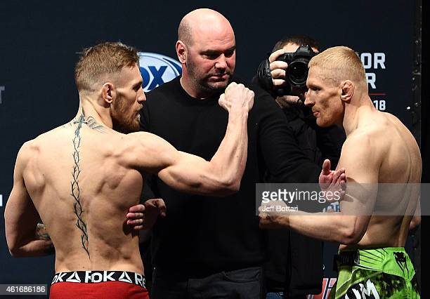 UFC featherweights Conor 'The Notorious' McGregor of Ireland faces off with opponent Dennis Siver of Germany during the UFC Fight Night Boston...
