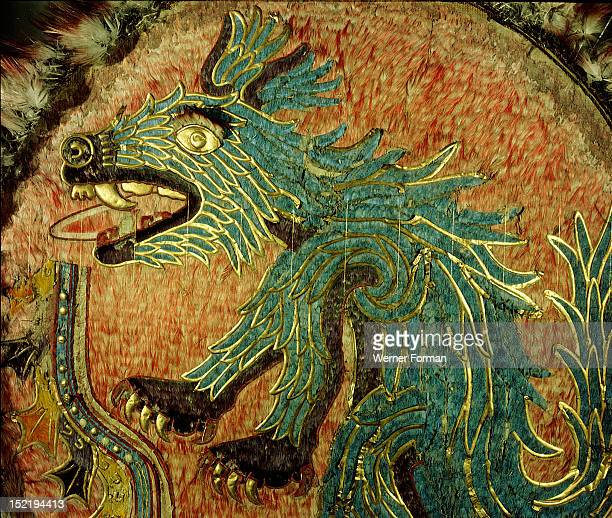 Featherwork shield almost certainly the ceremonial shield of Ahuitzotl who preceded Montezuma as Great Speaker Depicts a water beast holding a...