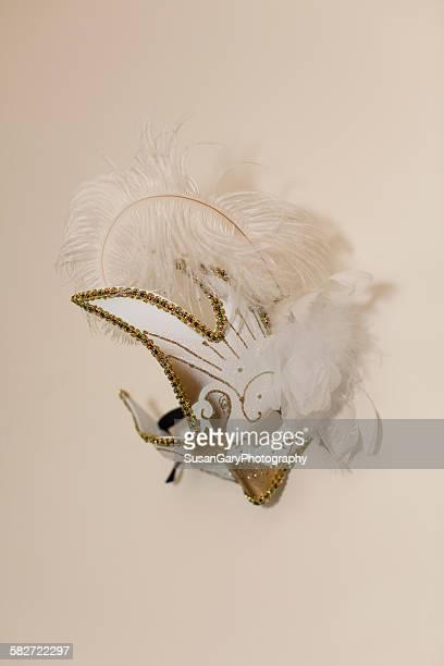 feathery white mardi gras mask on wall - gras bildbanksfoton och bilder