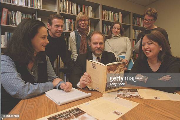 Feature about how MCClelland and Stewart produce a book At an editorial meeting Doug Gibson shows a copy of Alice Munro's new book With him are lr...