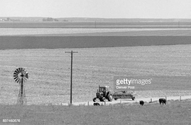 Feature art Region Eastern Colorado Washington County County Rd 38 a hay baler is pulled along a dirt road near Cope Co Credit The Denver Post