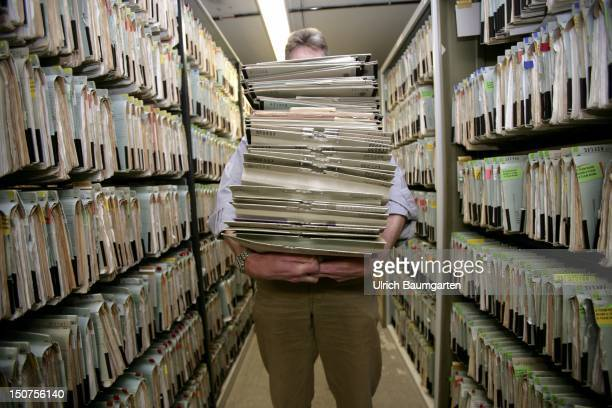 GERMANY Feature bureaucracy Our picture shows a man carrying a big mountain of files