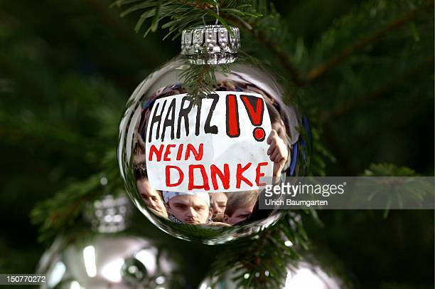 Feature Christmas surprise Hartz IV Arbeistlosengeld II Christmas tree decoration with the picture of a demonstration against Hartz IV Montage