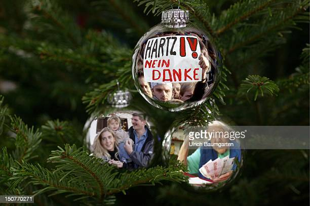Feature Christmas surprise Hartz IV Arbeistlosengeld II social reforms in Germany Christmas tree decoration with the pictures of a demonstration...