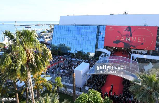 Feature Film jury presidents pose as they arrive on May 23, 2017 for the '70th Anniversary' ceremony of the Cannes Film Festival in Cannes, southern...