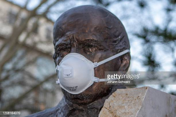 Feature Statue of Ignaz Semmelweis with protective mask by Coronavirus Affects Everyday Life In Austria at AKH Wien on March 24 2020 in Vienna...