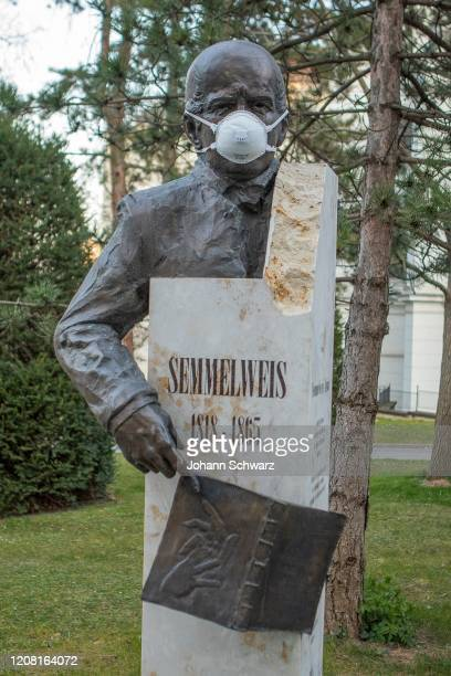 Feature, Statue of Ignaz Semmelweis with protective mask by Coronavirus Affects Everyday Life In Austria at AKH Wien on March 24, 2020 in Vienna,...