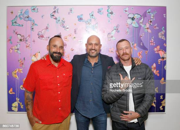 Featured artists Michael Muller and Sage Vaughn and gallery owner Steph Sebbag attend the Michael Muller and Sage Vaughn exhibit presented by...