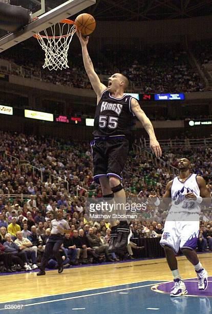 Jason Williams of the Sacramento Kings soars to the basket for a layup after beating Karl Malone of the Utah Jazz on the break at the Delta Center in...
