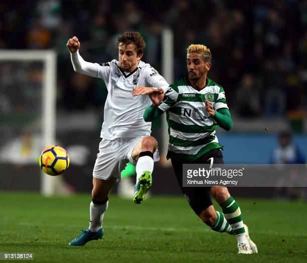 LISBON Feb 1 2018 Ruben Ribeiro of Sporting vies with Rafael Miranda of Guimaraes during the Portuguese League soccer match between Sporting and...
