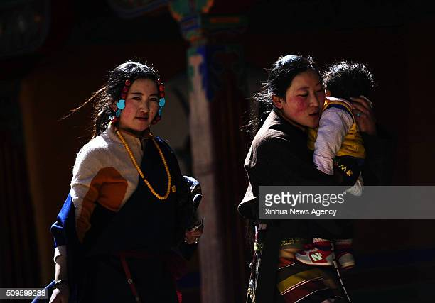 LHASA Feb 11 2016 Tibetan Buddhism believers are seen at Drepung Monastery in Lhasa capital of southwest China's Tibet Autonomous Region Feb 11 2016...